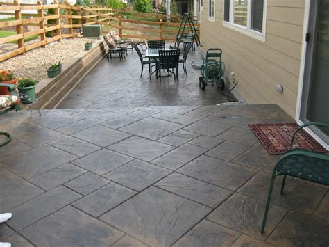 deck and sted concrete patio modern home exteriors