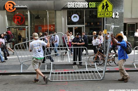 nypd barrier section climate protesters settle for broadway sit in thestreet