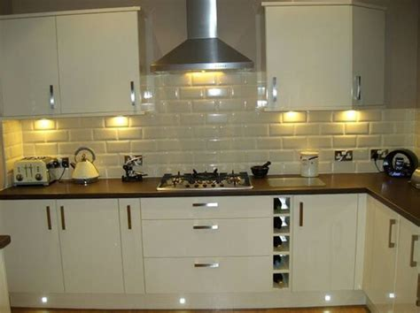 tile under kitchen cabinets bevelled subway tiles with under cabinet downlights
