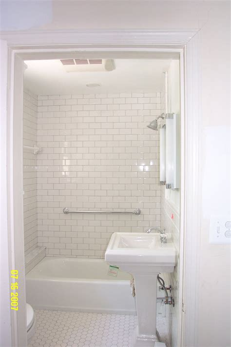 small white subway tile bathroom home design ideas