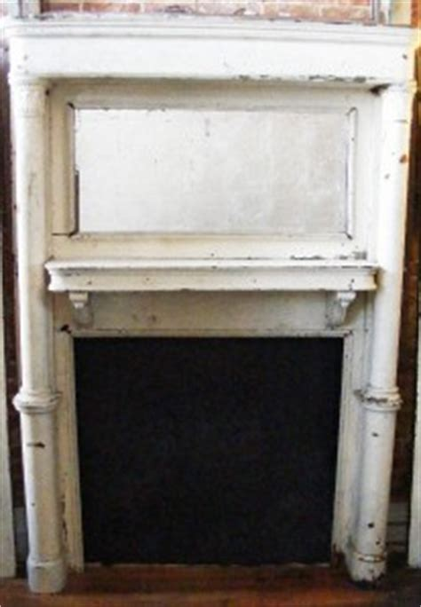 antique wooden white distressed painted fireplace