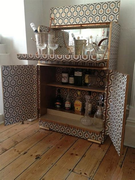 vintage cocktail cabinet covered in cole wallpaper