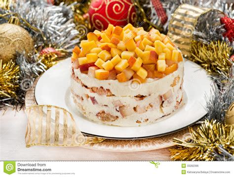 cheesecake with peaches with christmas decorations royalty