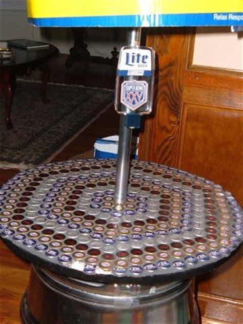 how to make a bottle cap table i like the table top idea and the use of old kegs but i