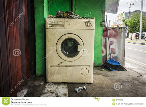 Front Door Washing Machine The White Washing Machine With Front Door Near Green Wall And A Broom Photo Abandoned In