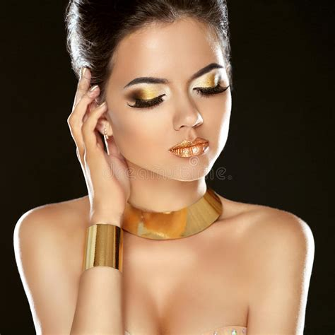fashion beauty girl isolated on black background golden