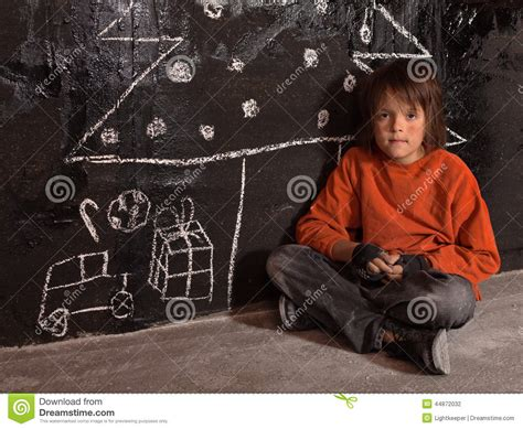 poor kid at christmas time on the street stock photo