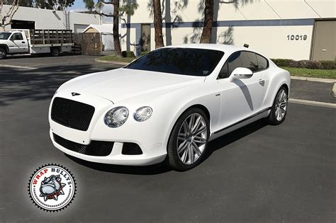 white bentley bentley wrapped in 3m satin white wrap bullys