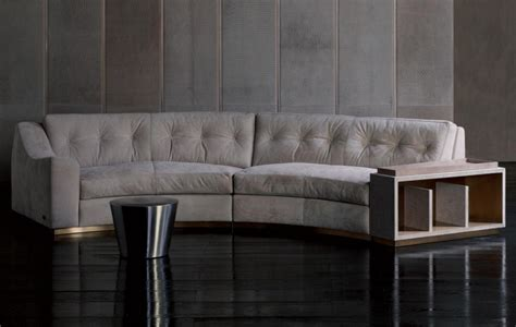 semi circular sofa with open shelf golden circus rugiano