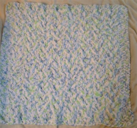 bernat pattern video cable baby blanket knit with bernat baby blanket yarn in