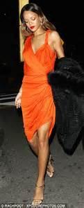 rihanna dazzles in a bright orange grecian gown as steps