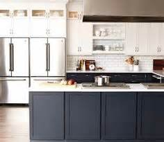 Midnight Blue Kitchen Cabinets Kitchen Inspiration On Brass Subway Tiles And Black Cabinets