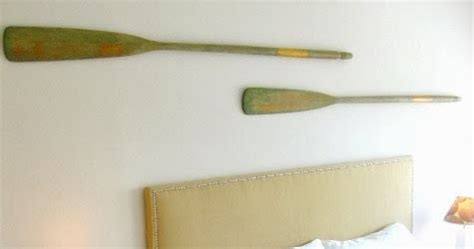how to hang oars or paddles in an x shape the inspired how to hang oars and paddles on a wall like a pro