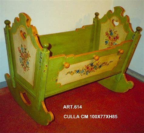 culle artigianali letto culla in legno decorato