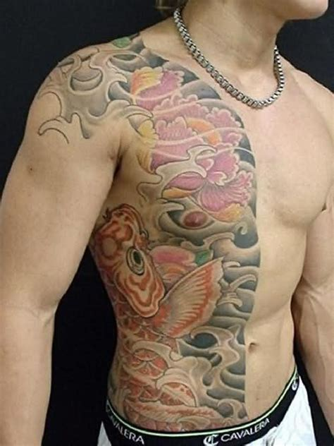 tattoo on chest and shoulder koi fish buddhist tattoo on shoulder chest