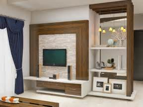 Wall mountable tv unit with a back drop of creamy stonecladded wall