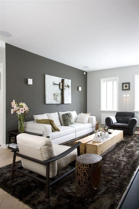 living room dark grey wall light grey couch shiny