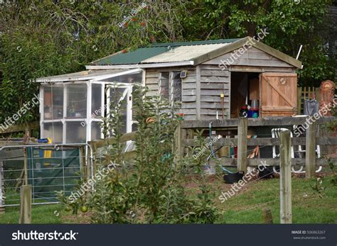 Shed With Greenhouse Attached by Wooden Garden Shed Small Greenhouse Attached Stock Photo