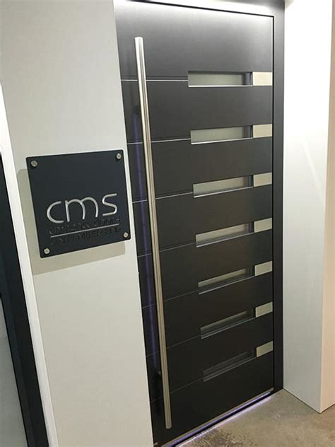 house numbers and name plaques cms front doors
