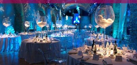 party themes company love the large glass centerpieces disco balls instead