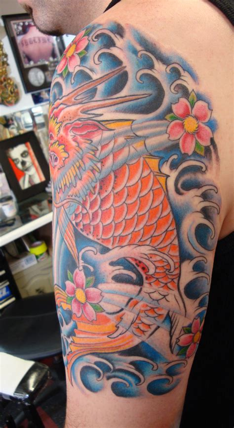 tattoo dragon fish dragon fish tattoo with waves and cherry blossoms opie ortiz