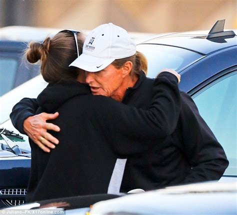 bruce jenner spruced up to take mystery brunette to elton bruce jenner wears wedding band on right hand embracing