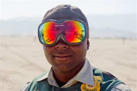 What Are The Rainbow Colors burning man leo with mirror goggles