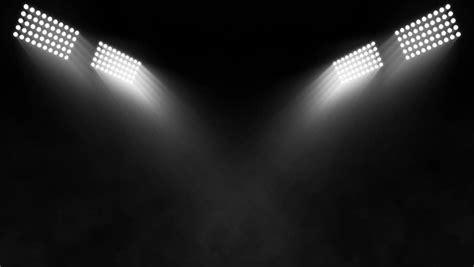 sky flood lights isolated of stadium flood lights turning on a black