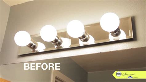 how to change a bathroom light fixture bathroom makeover tip replace your bathroom lighting