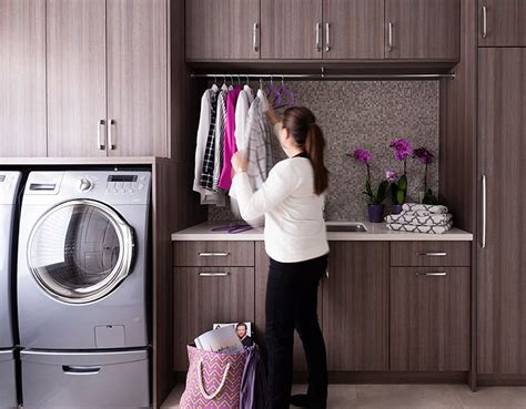 laundry room cabinets with hanging rod laundry rooms mudrooms organized interiors