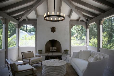 Screened In Outdoor Rooms by Fall Weather And An Outside Fireplace