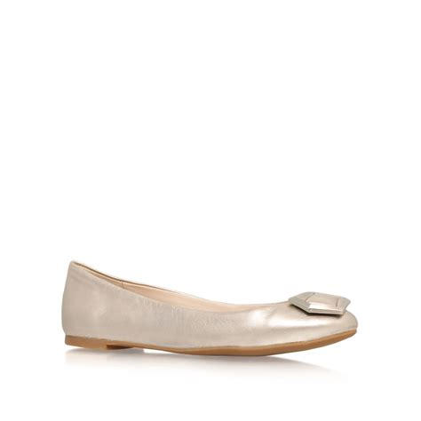 nine west abiss flat slip on shoes in gold lyst