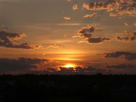 sunset  horizon cloudy weather sunset  horizon