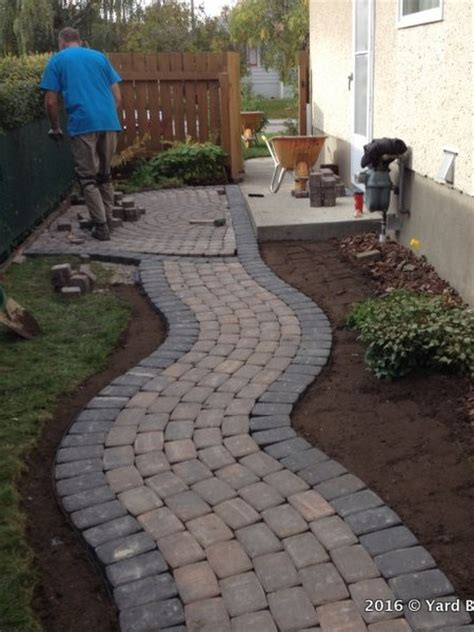 before and after interlock curving pathway yard busters