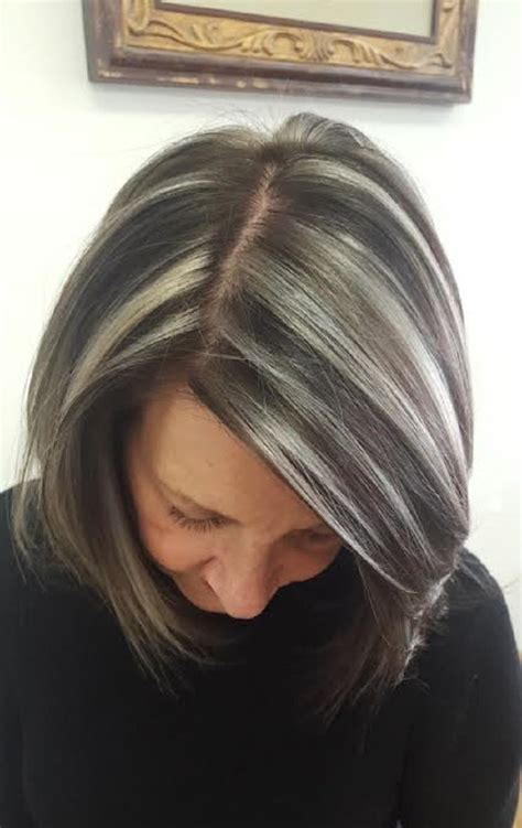 highlights on dark hair 50 28 edgy and elegant haircuts for women over 50 ritely