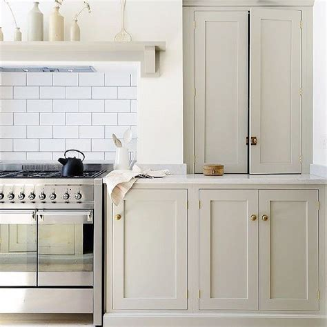 colored cabinets kitchen putty colored cabinets white subway tile and
