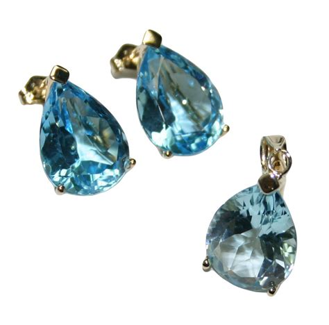 Is This Really A Gold Topaz by 14k Yellow Gold Blue Topaz Earings And Pendant Set