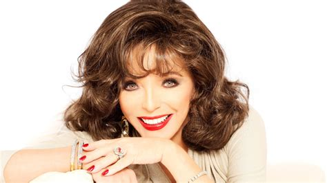 joan collins posts video of aftermath of blaze at london