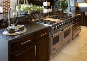 kitchen with stove in island islands kabco kitchens