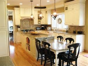 kitchen island with built in table the island with the seating at the end and the white
