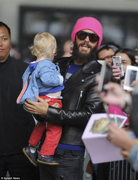 jared letto band jared leto cradles a child as he heads to radio 1