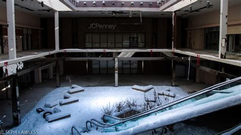 seph lawless rolling acres eerie photos of snow blanketing the interior of an abandoned shopping mall in akron ohio