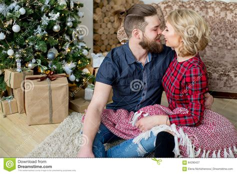 home lovers happy couple of lovers sitting near the sofa stock photo image 84290427