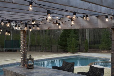 String Lights On Patio Hanging Patio String Lights A Pattern Of Perfection Yard Envy