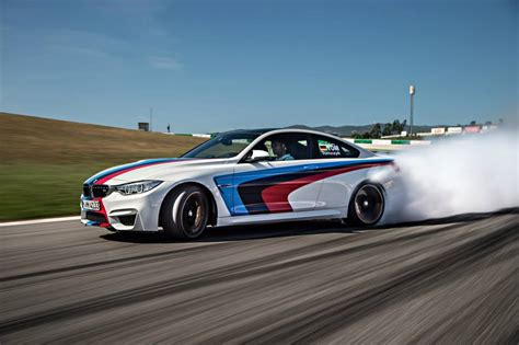 bmw drift bmw m4 coupes drifting at portimao circuit gtspirit