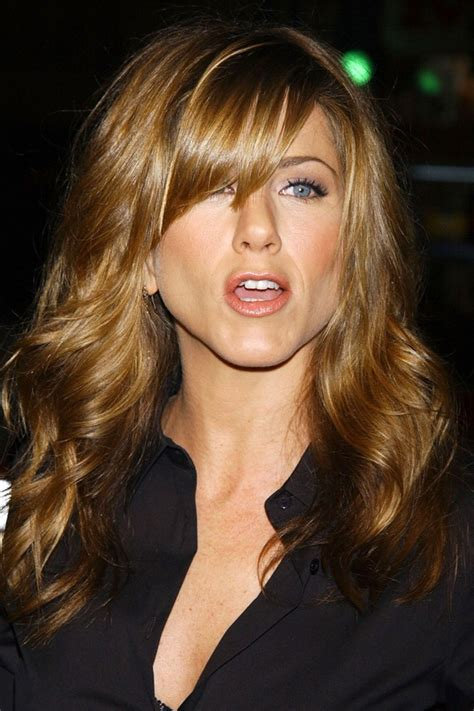jennifer aniston steps out with new blond bangs while into the science of jennifer aniston s use of hair as a prop