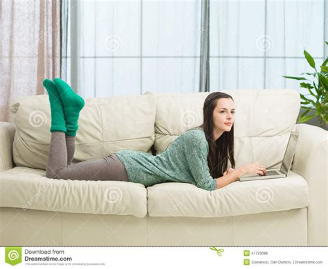 lounging on the couch teenage girl relaxing at home stock photo image of