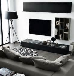 Superbe Tapis Salon Noir Et Blanc #4: un-salon-en-noir-blanc-et-gris-idee-deco-salon-aux-lignes-%C3%A9pur%C3%A9es-peinture-murale-blanche-canap%C3%A9-gris-lampe-design-et-meuble-tv-noirs-e1477051927635.jpg