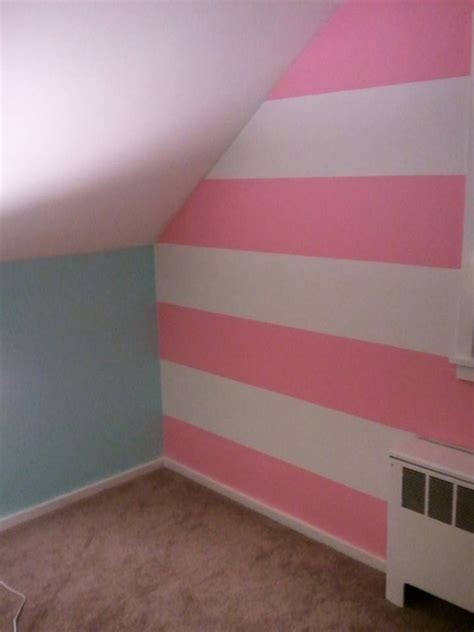 blue striped walls pink and white striped accent wall shared nursery ideas