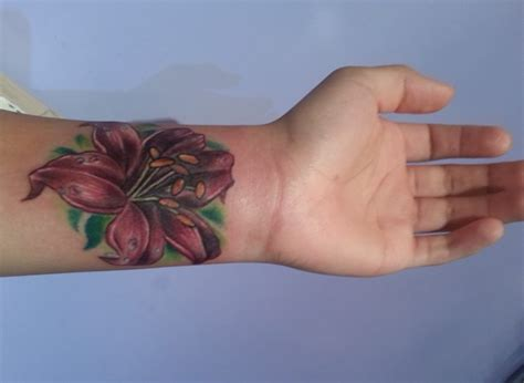 lily flower tattoos on wrist 34 awesome wrist flower tattoos